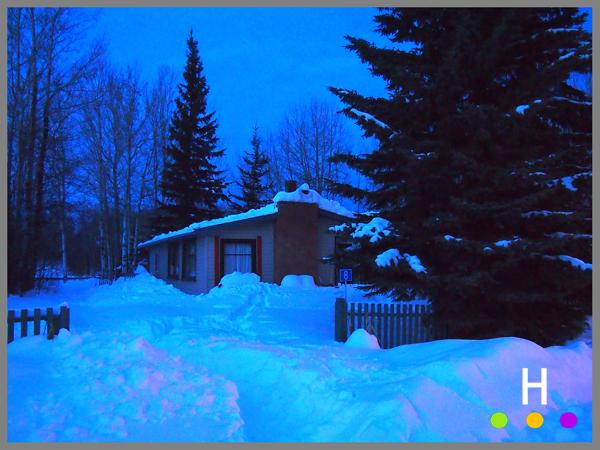 winter cabin at night